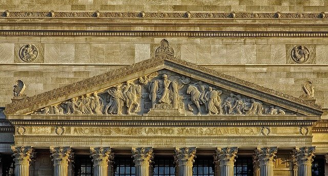 Photo of the Front of the US National Archives building in Washington DC.